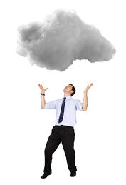 Business man lifting a cloud - isolated over a white background