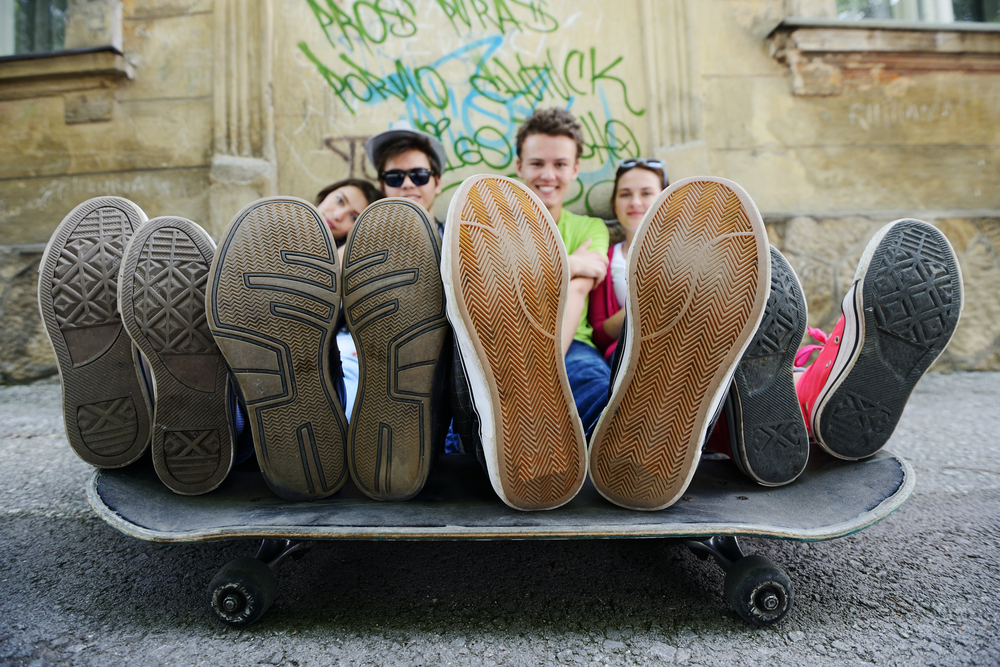 Urban stylish trendy young teenage people with legs on skate-2